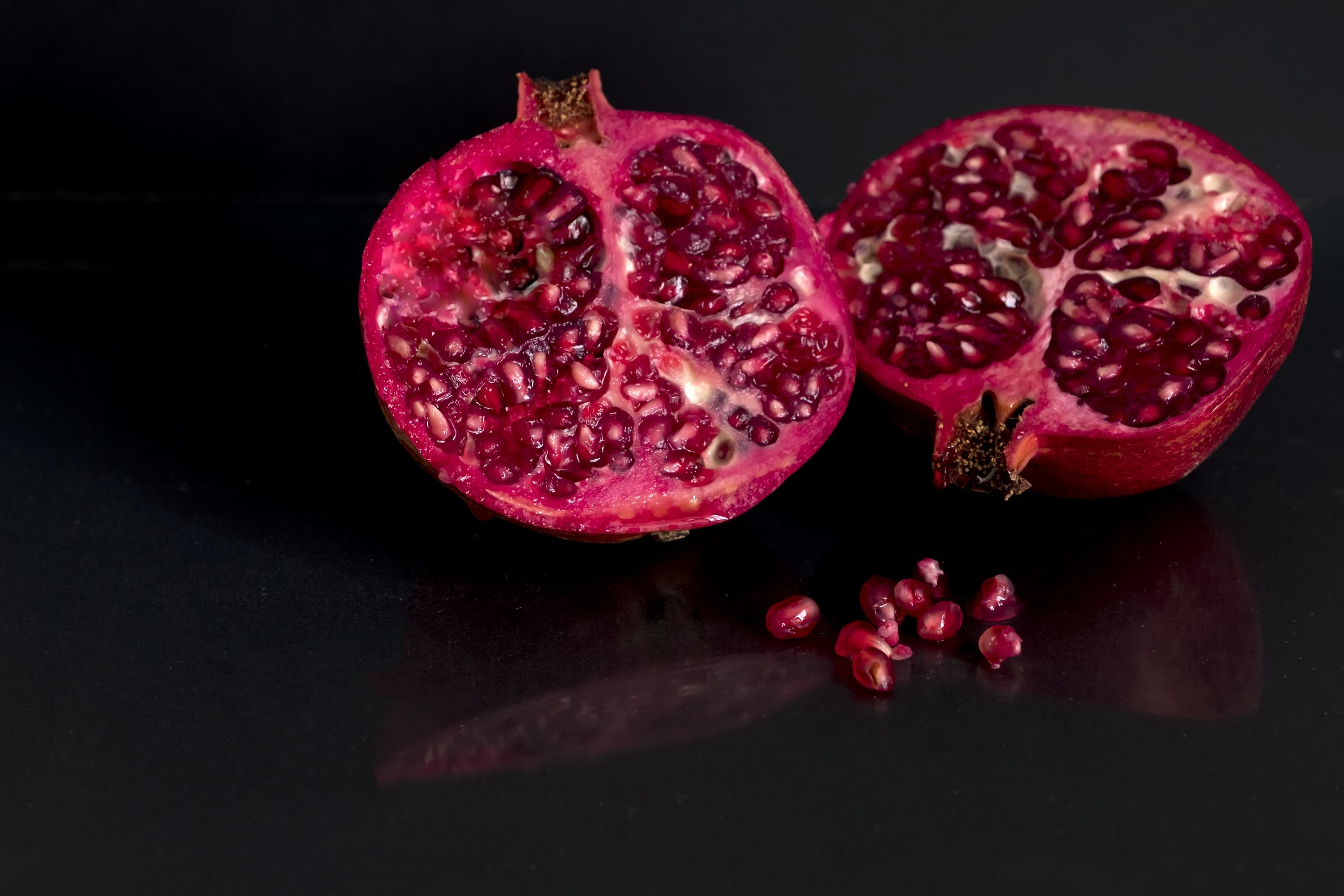 focus photo of sliced red fruit