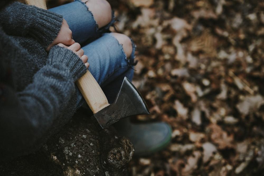 person holding axe
