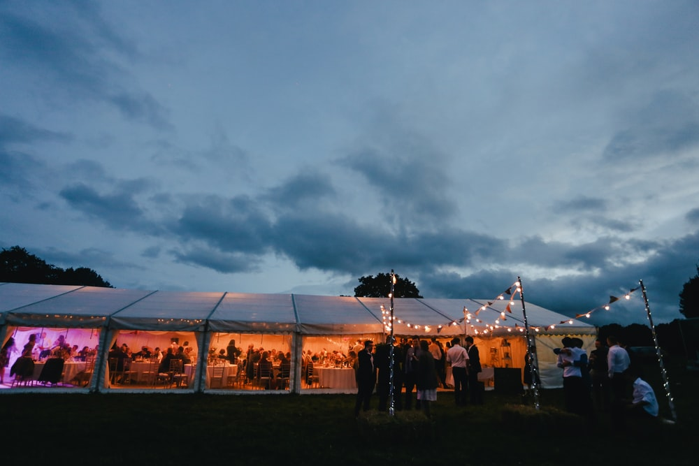 landscape photography of white canopy tent