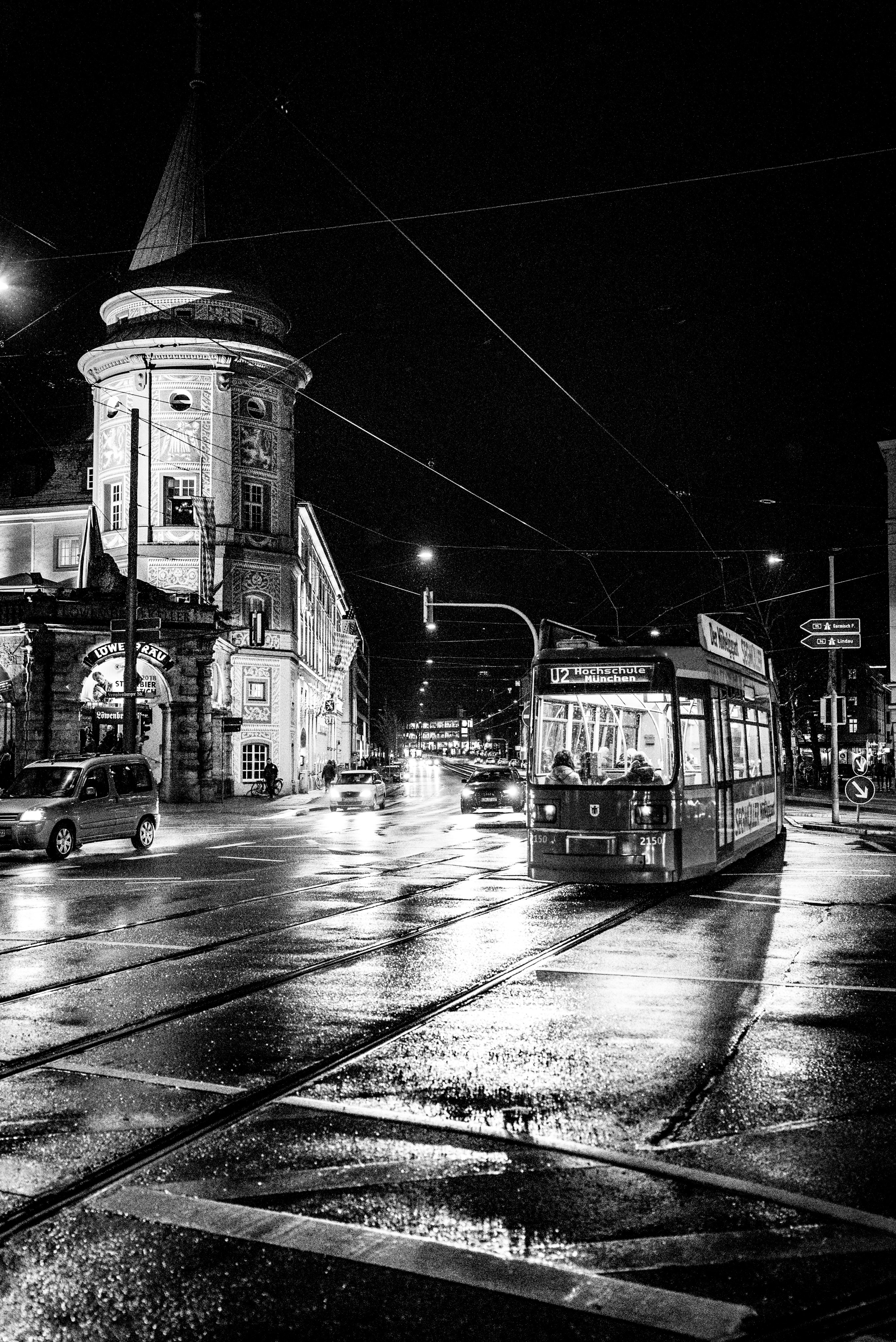 grayscale photography of tram near building