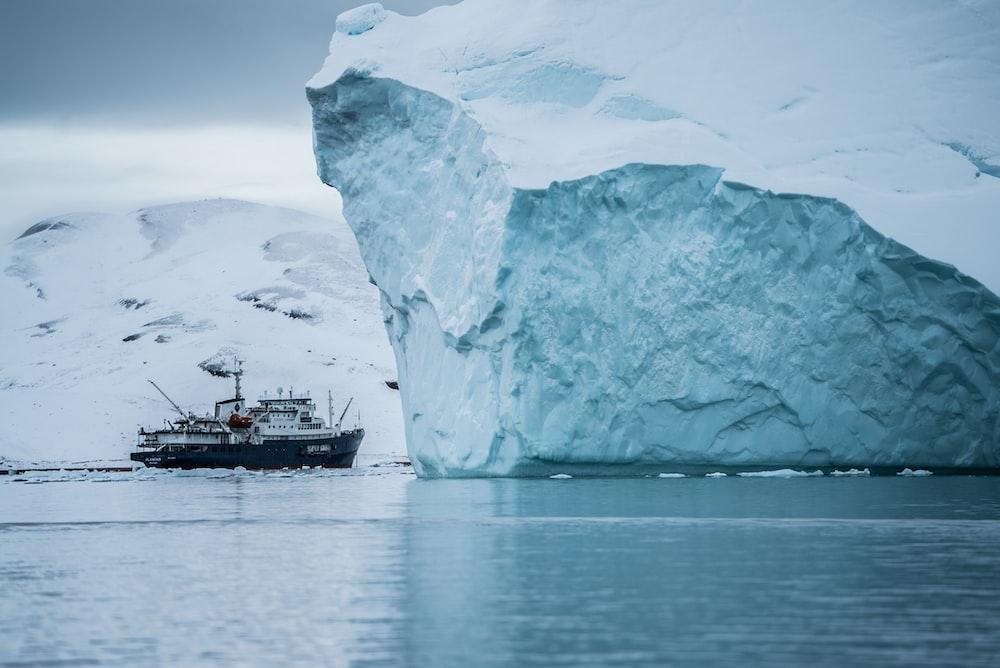 boat beside iceberg
