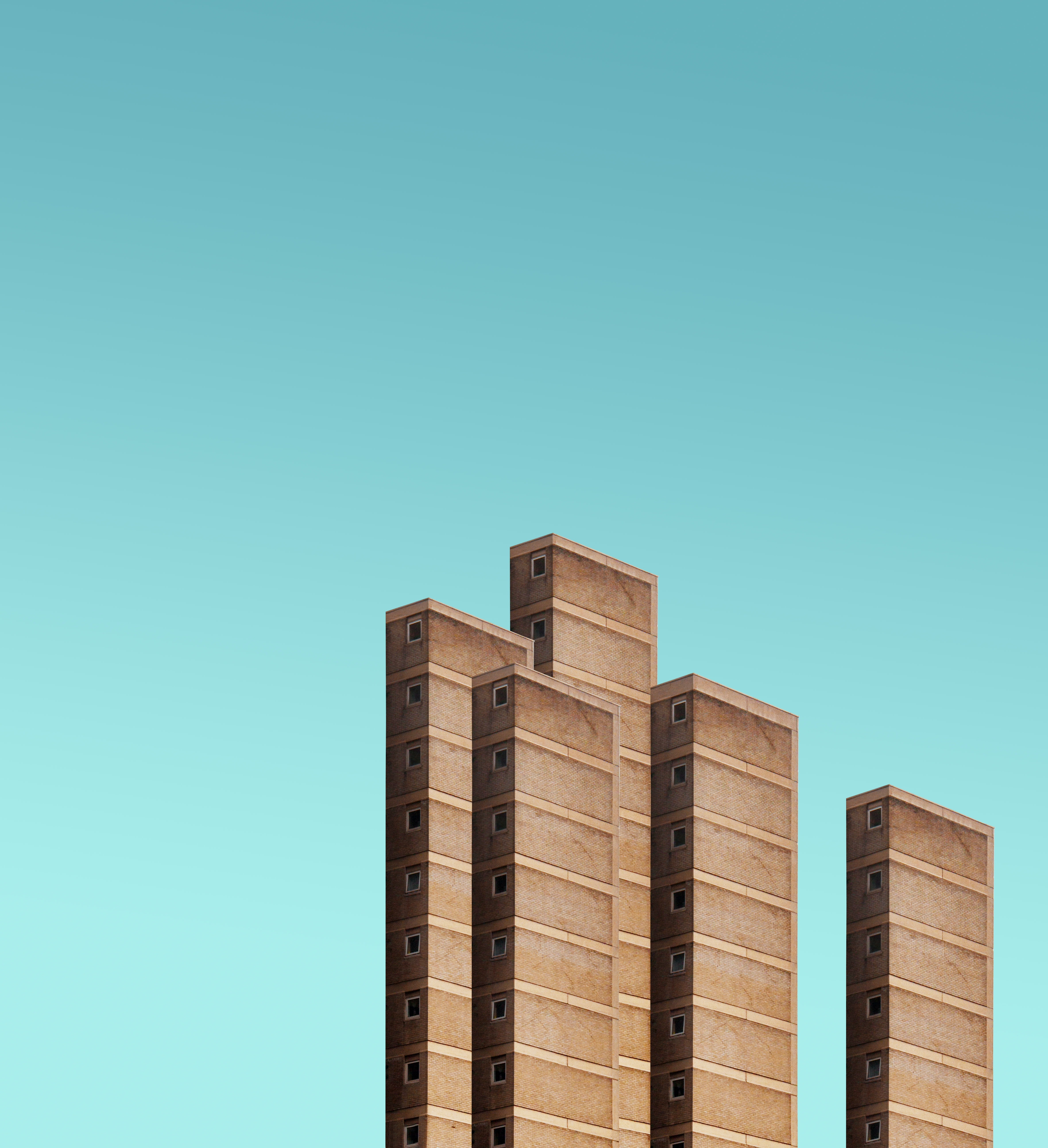 five brown high rise buildings