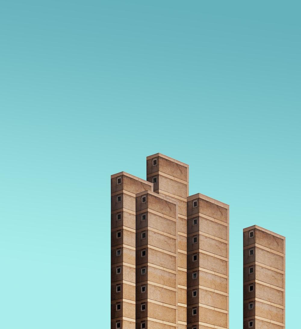 five brown high rise buildings