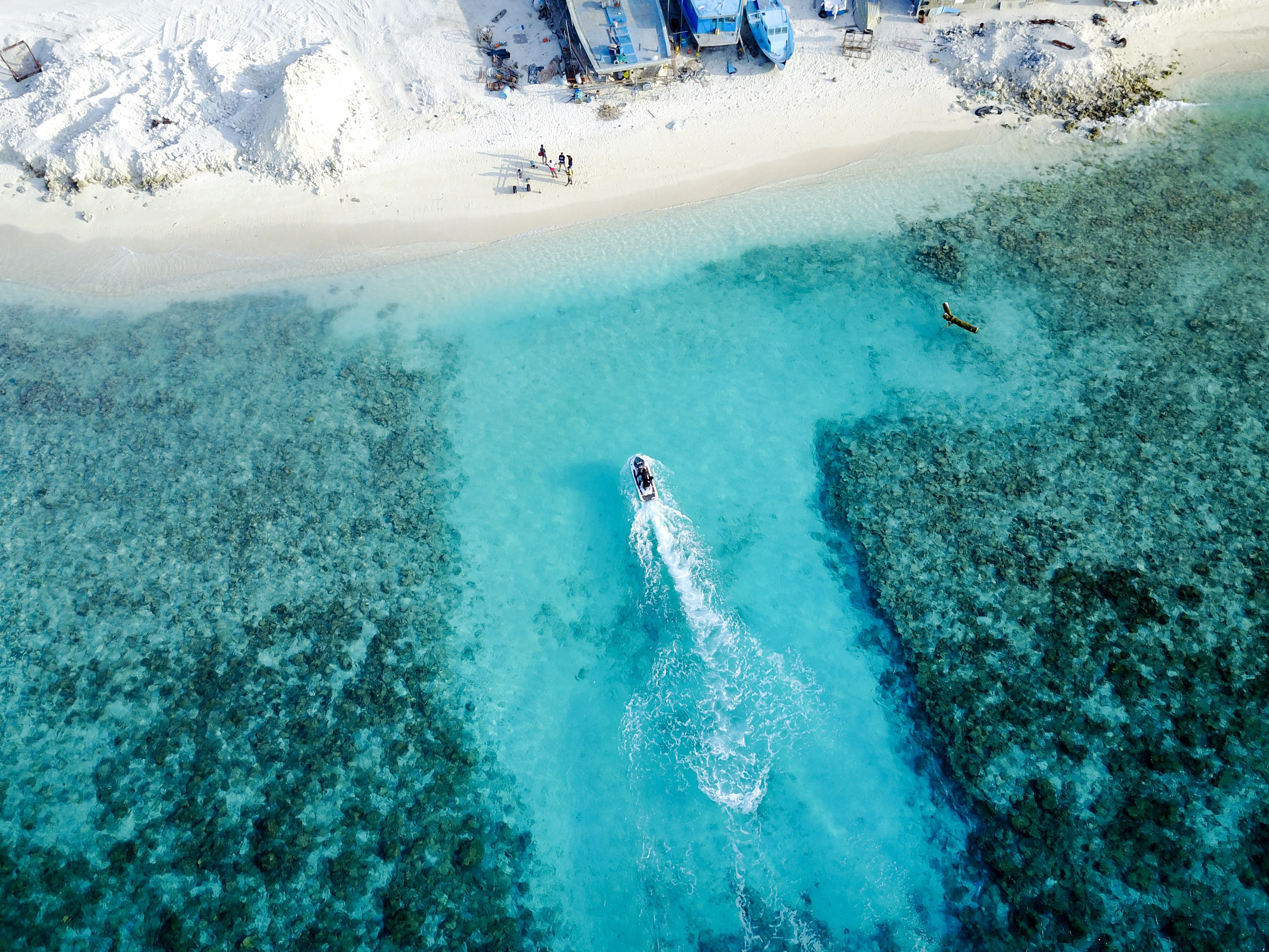aerial photography of boat on ocean during daytime