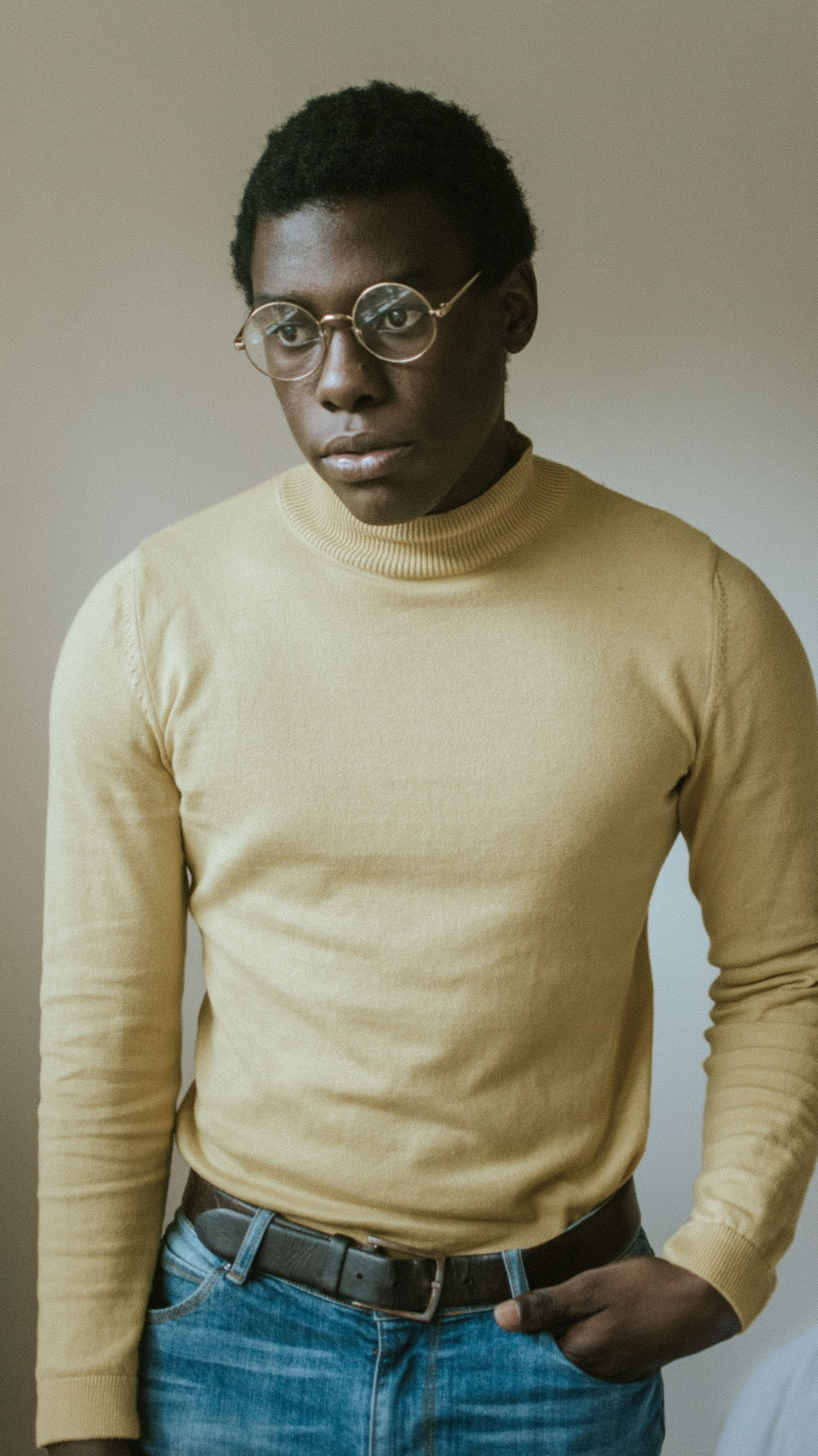 man wearing yellow sweater