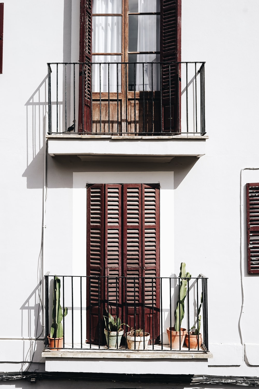 2-storey house with louvered windowpane doors