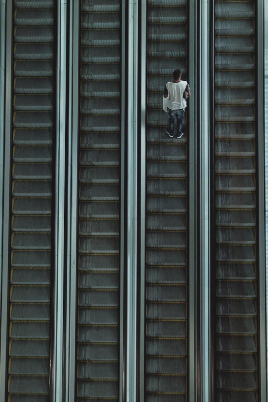 man riding on escalator