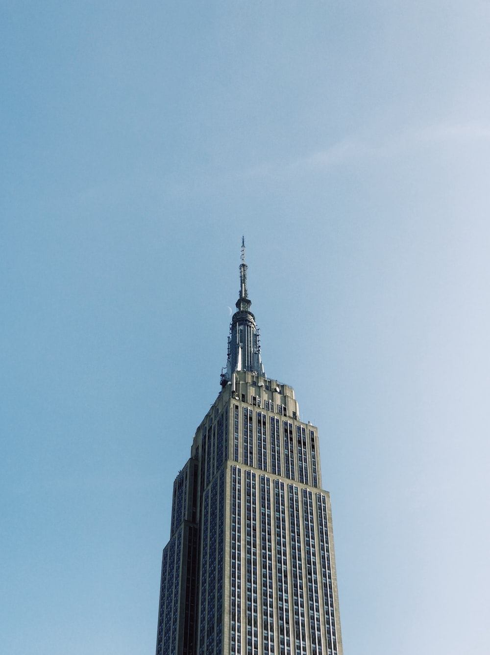 low-angle photography of Empire State Building, New York under blue sky during daytime