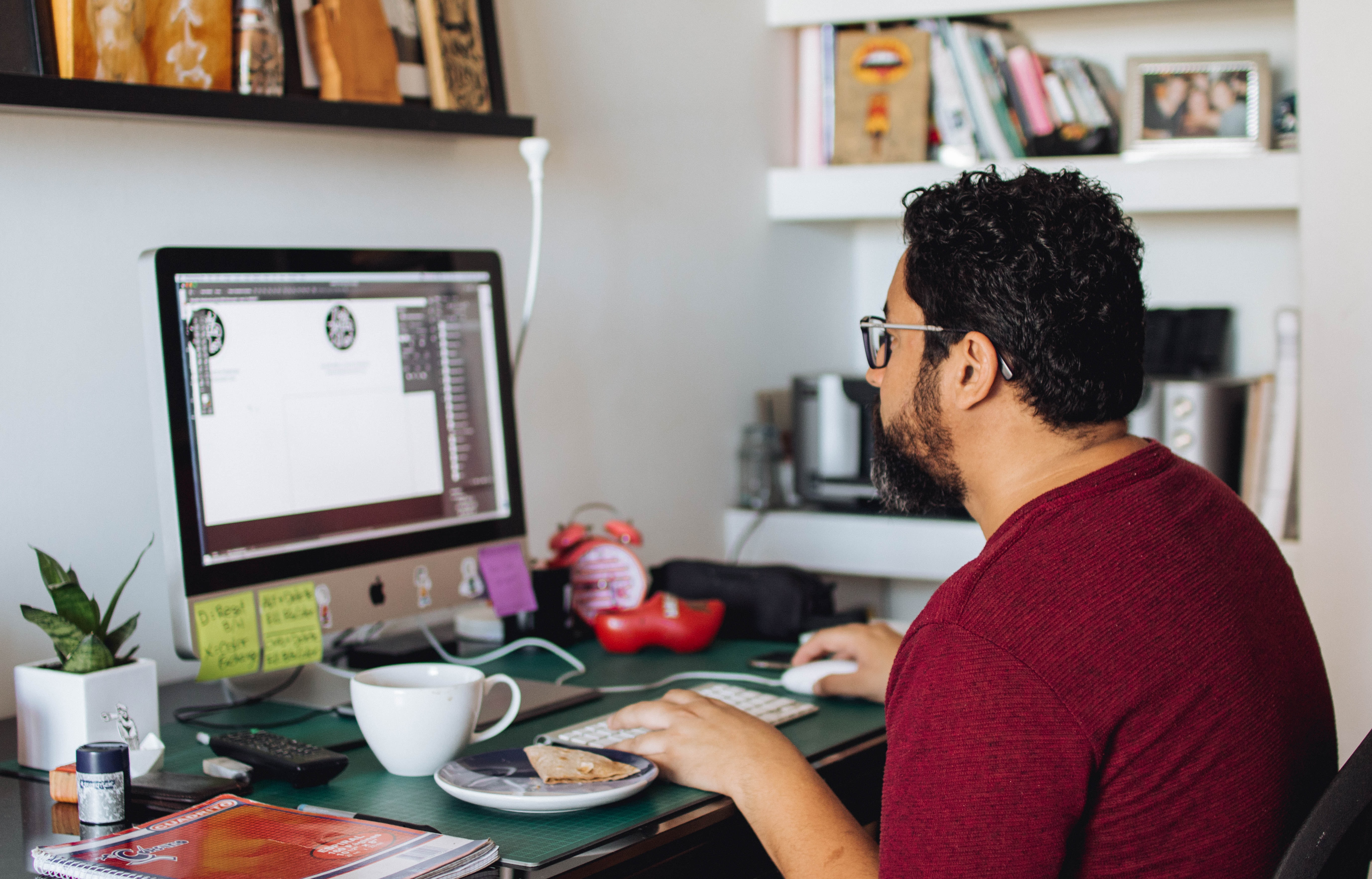 man using silver iMac