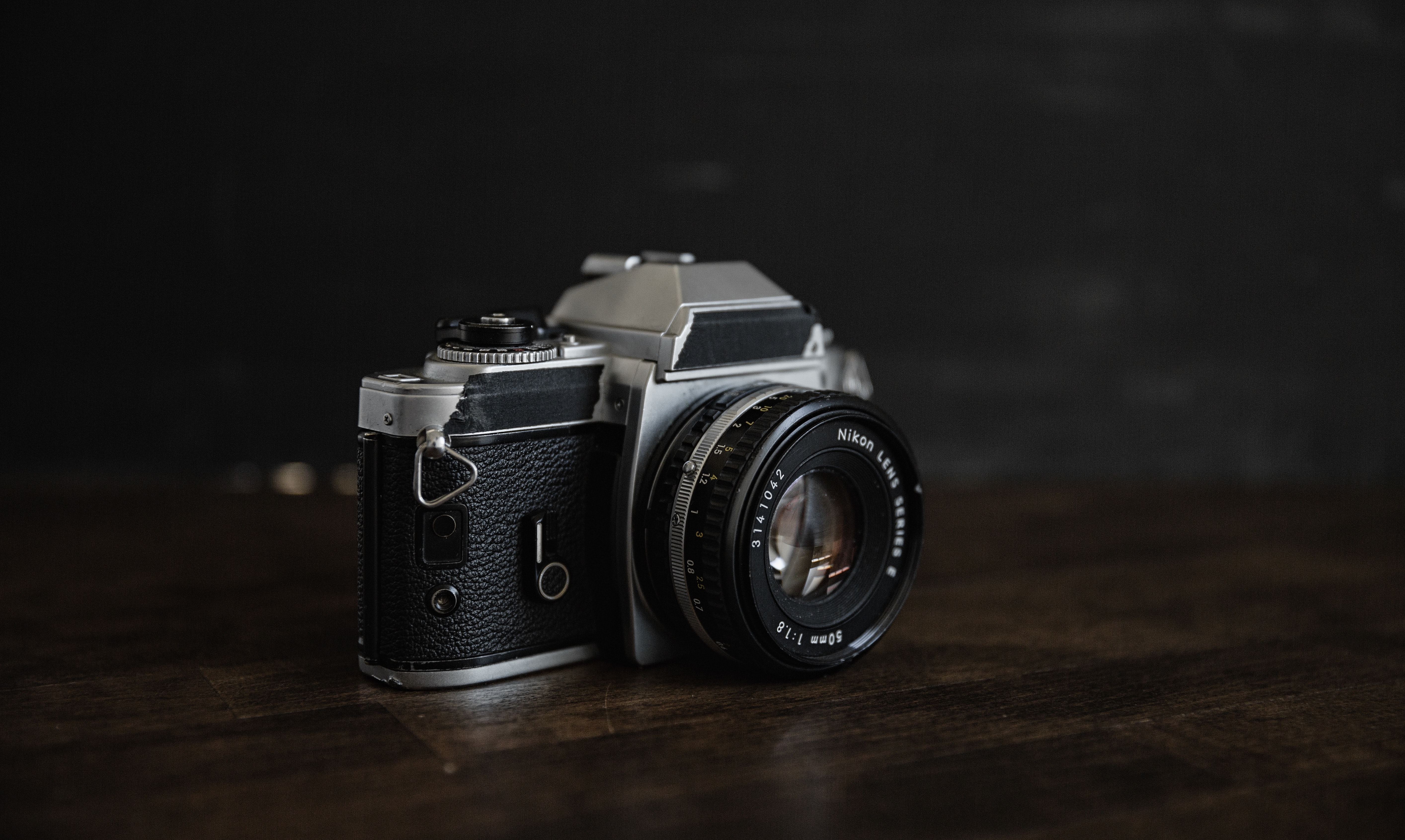 grey and black point-and-shoot camera