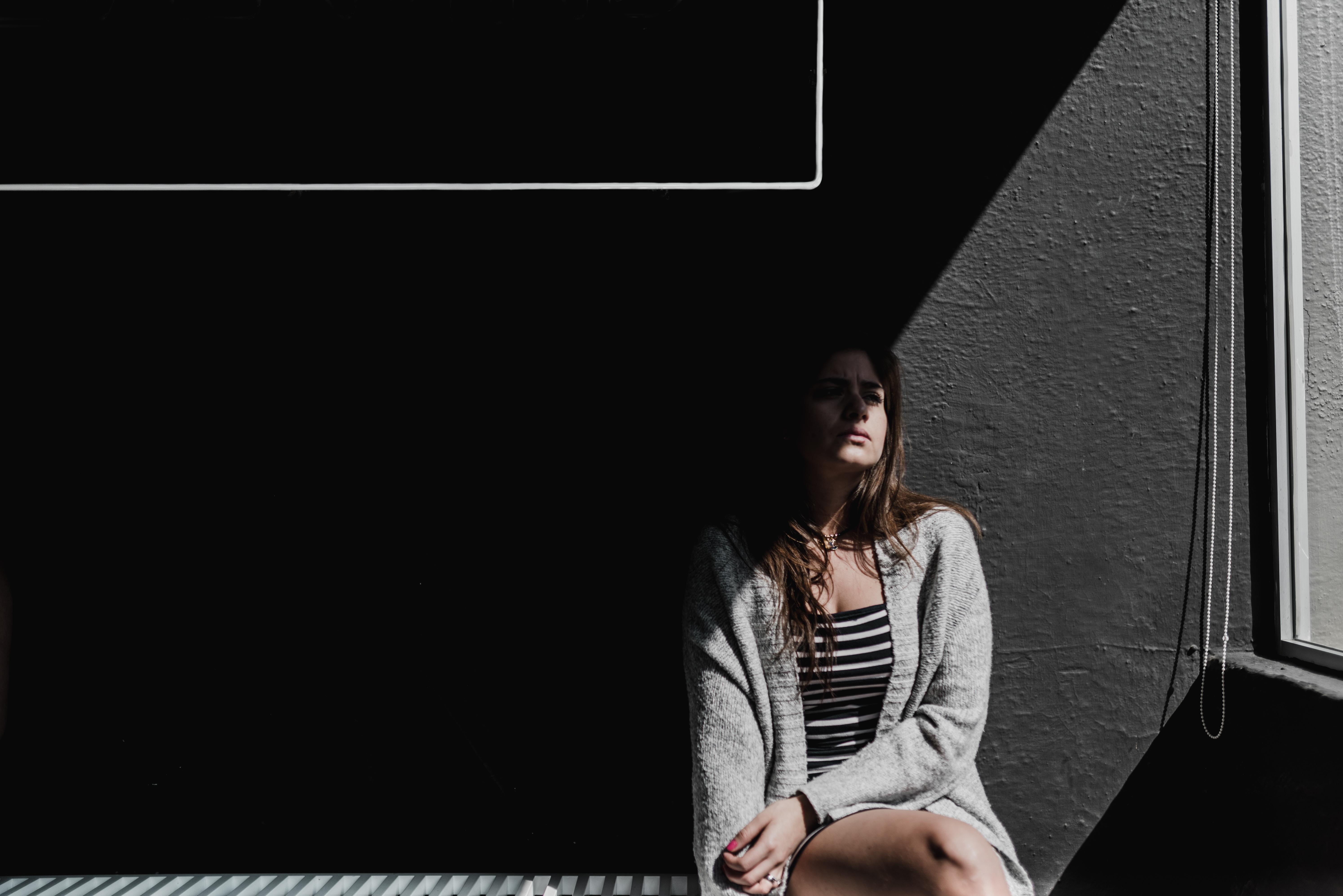 woman sitting on white bench