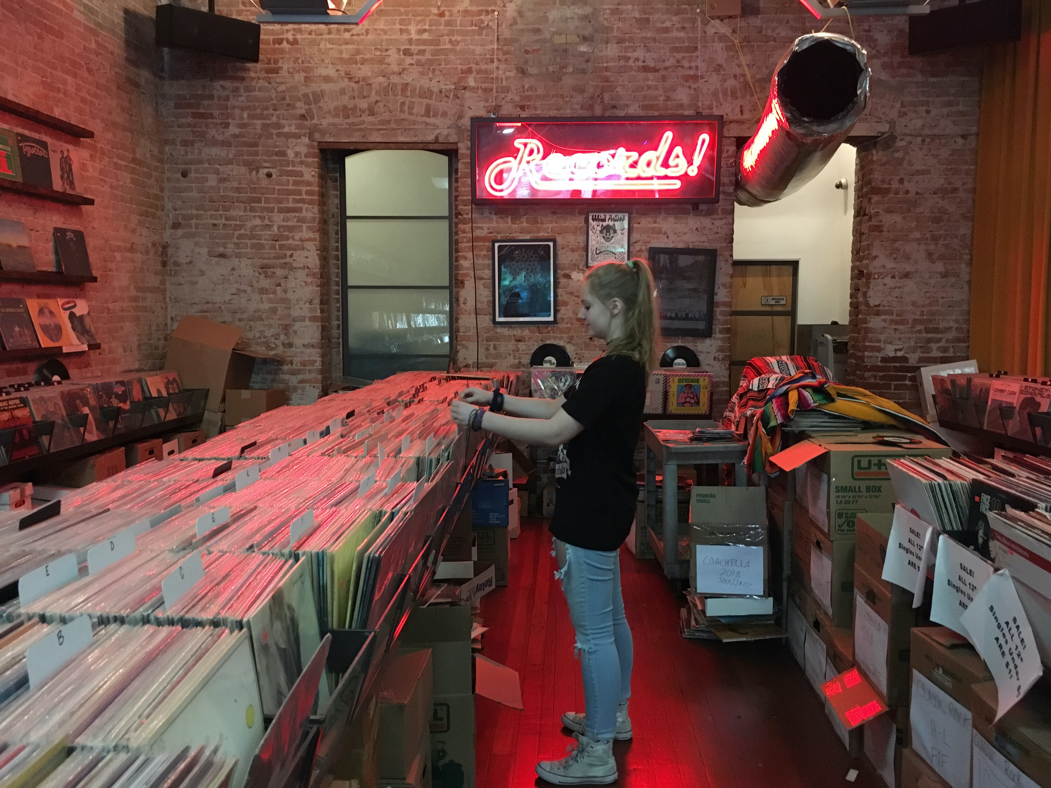 girl standing in front of books