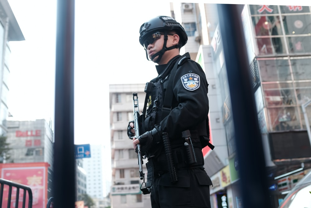 police holding rifle while standing