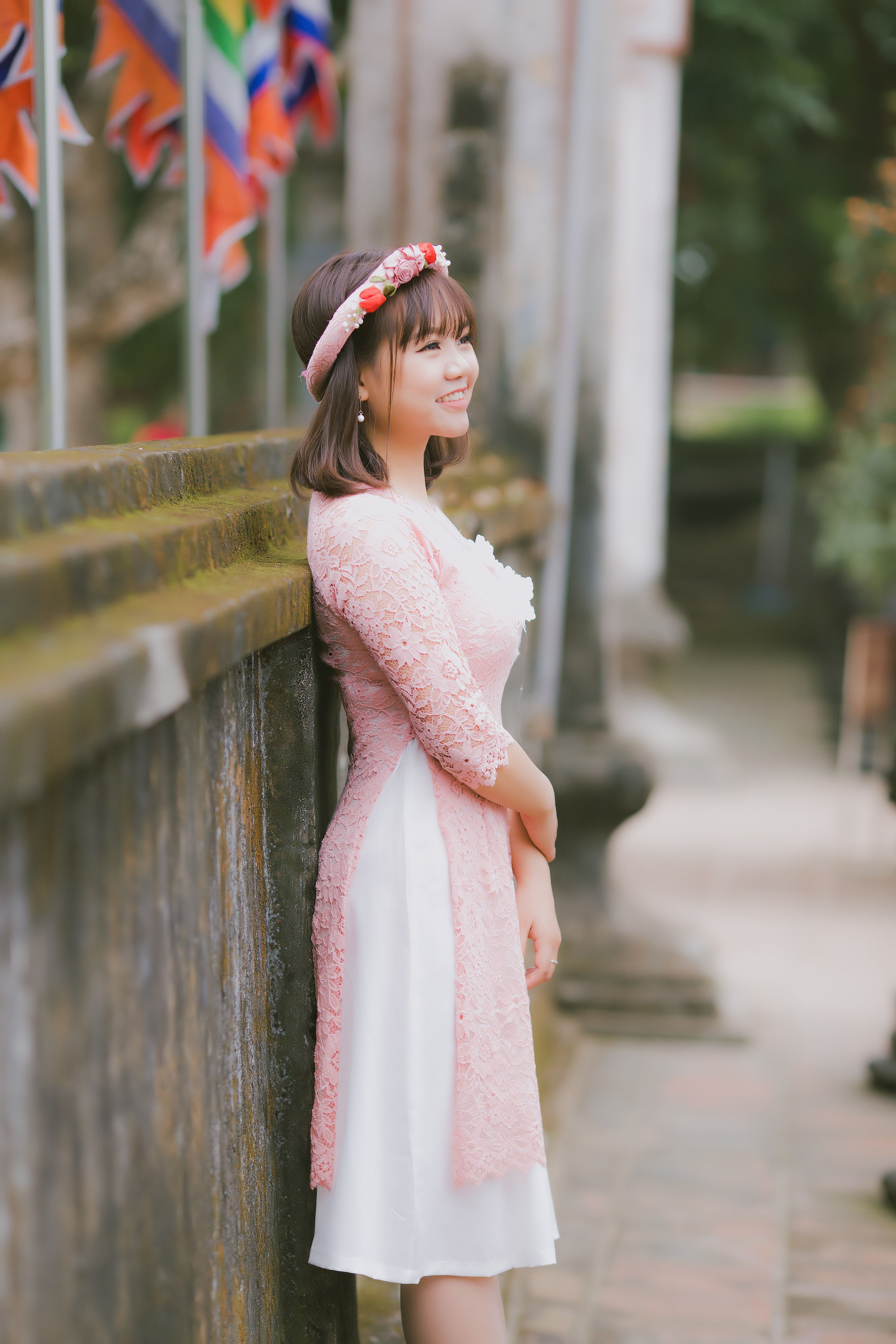 smiling woman in pink floral dress