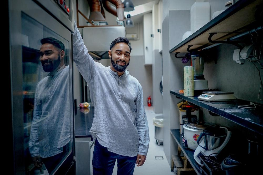 man standing in kitchen