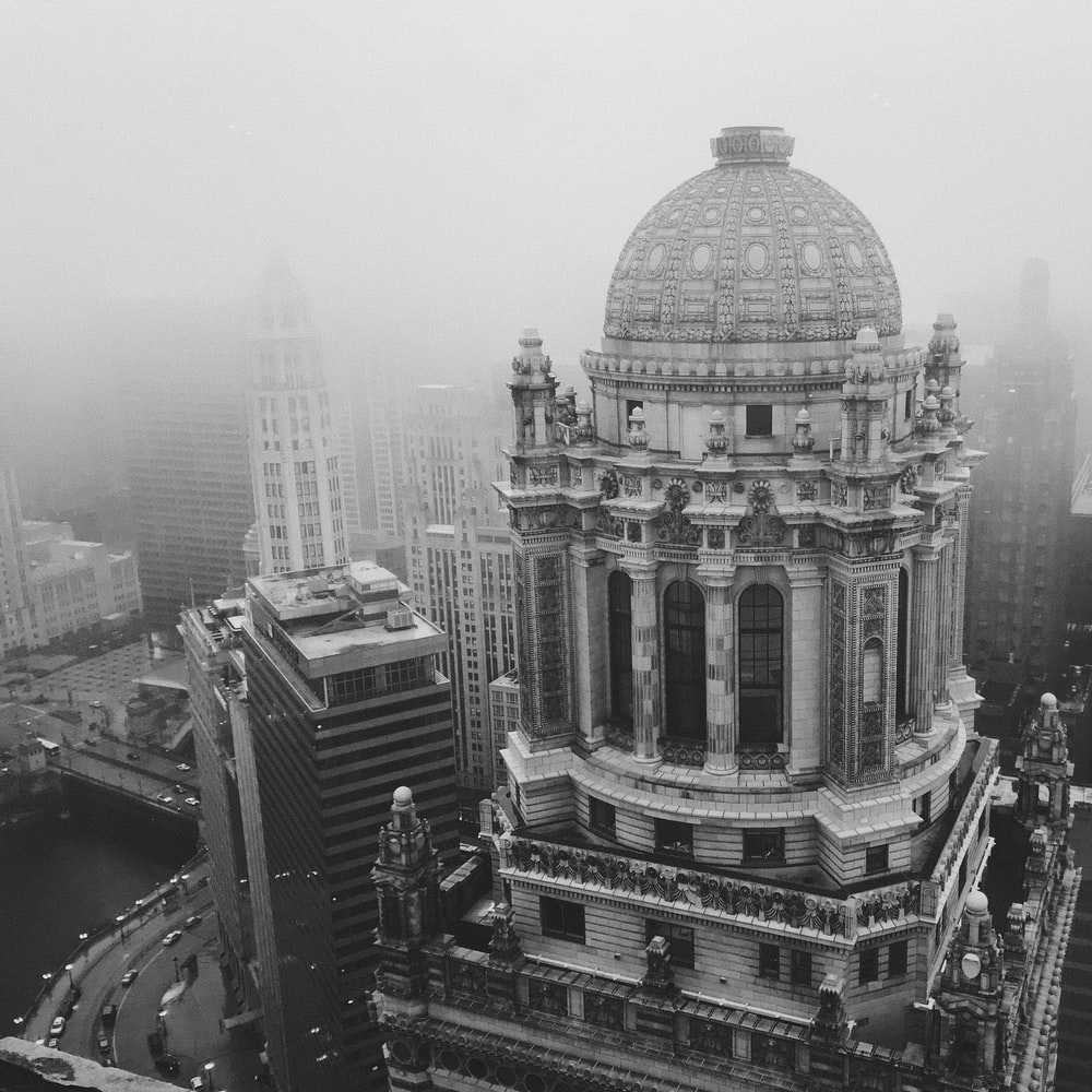aerial grayscale photo of dome-top building during daytime