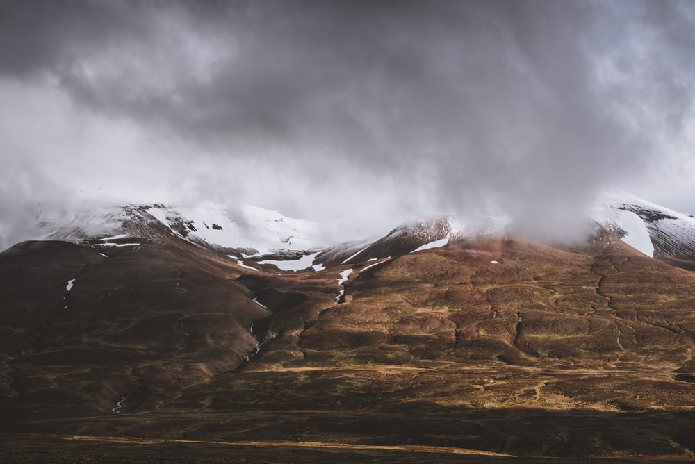 landscape photo of mountain covered by clouds