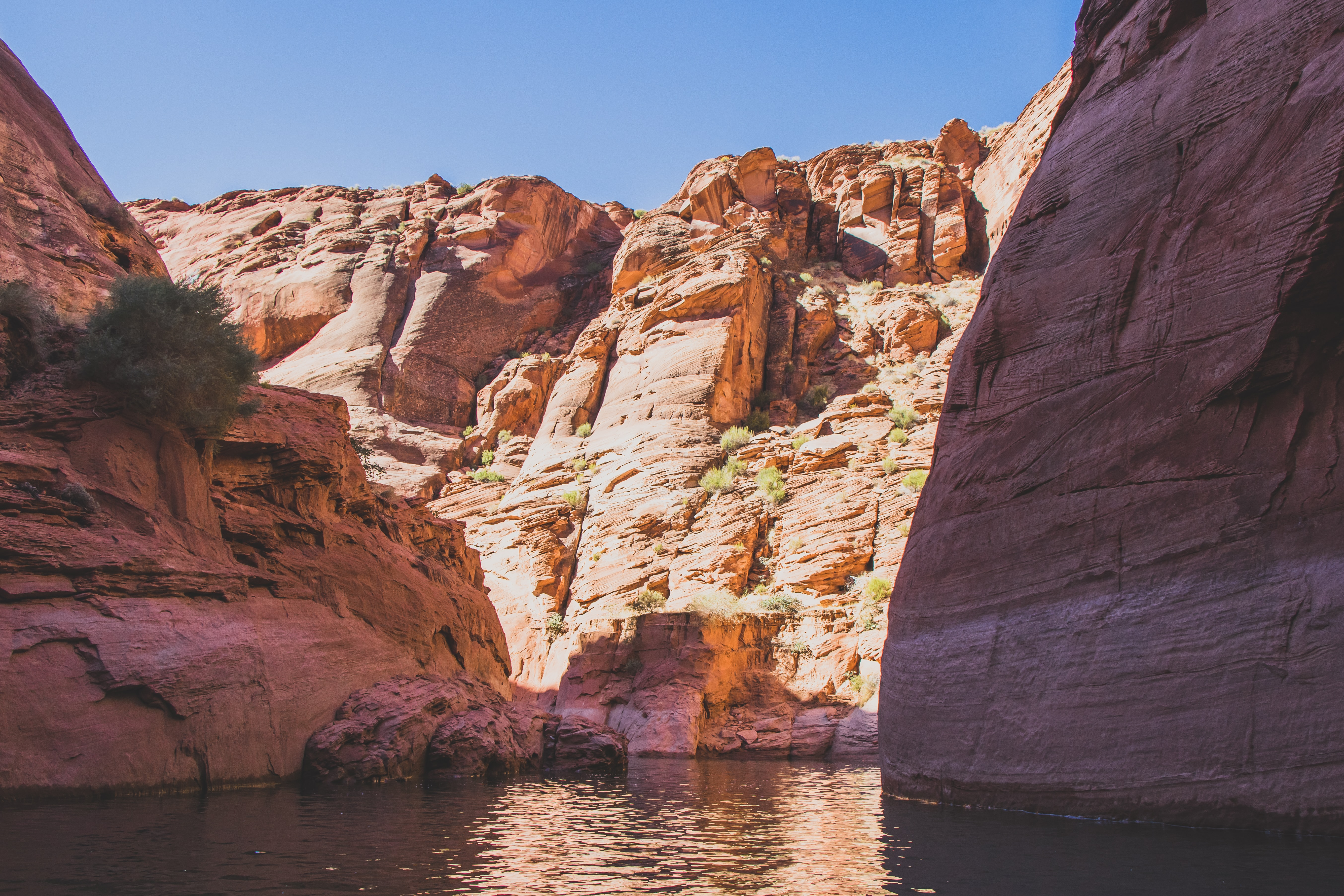 river surrounded of brown cliffs during daytime