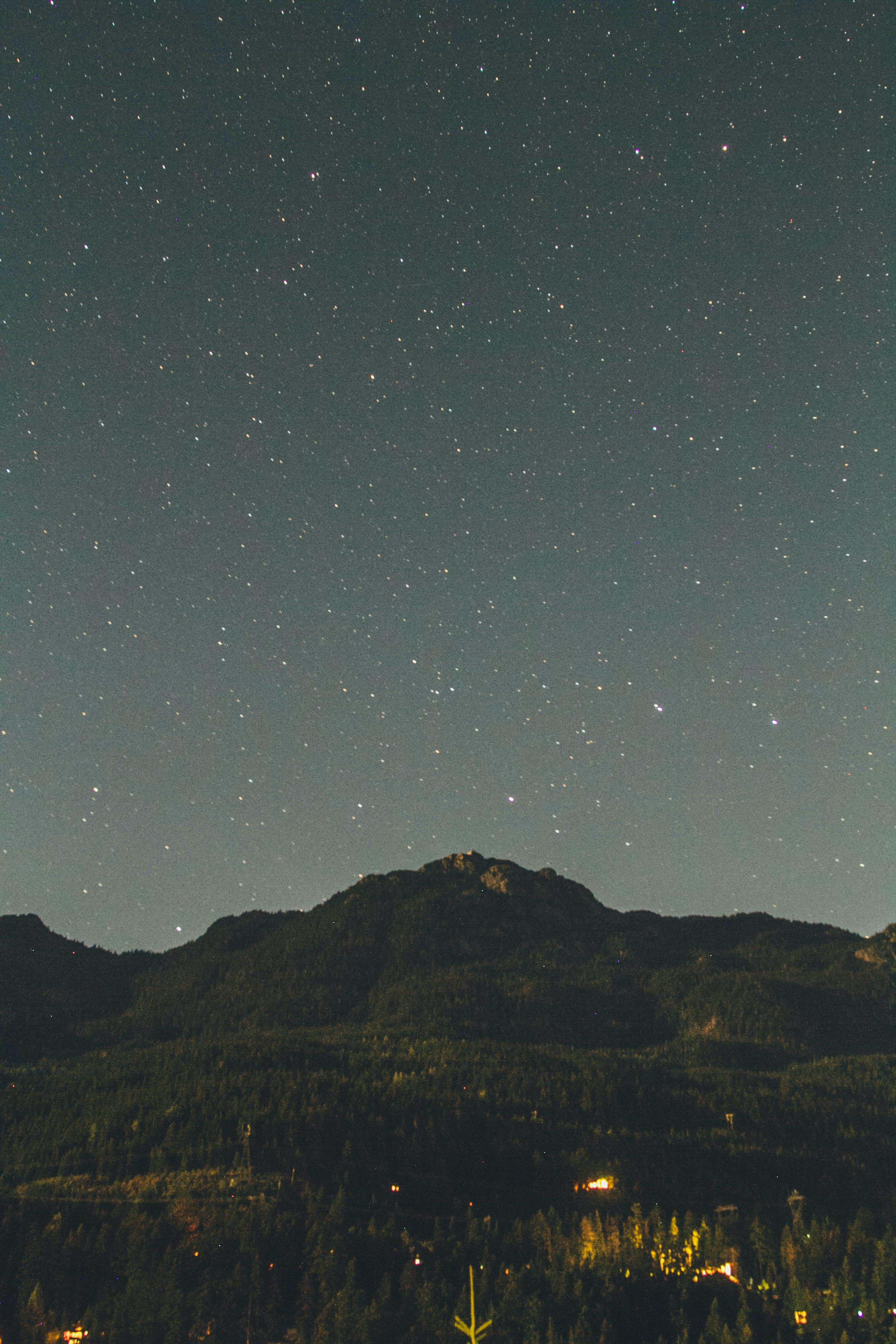 mountain under stars