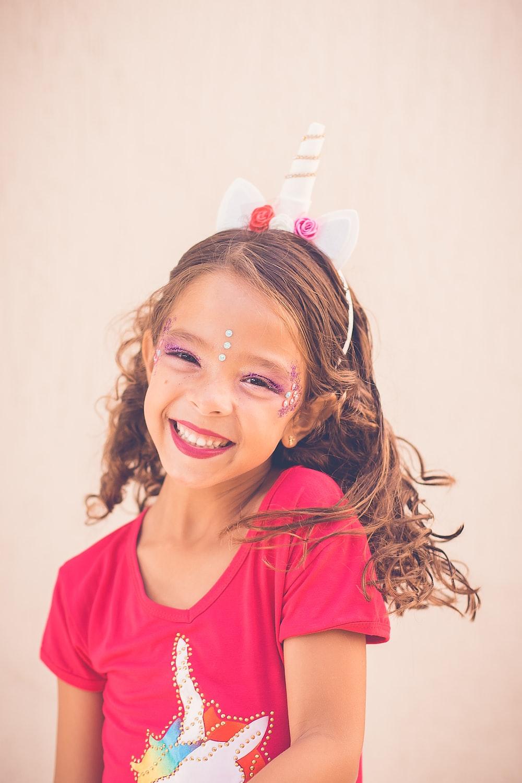 girl in pink shirt smiling