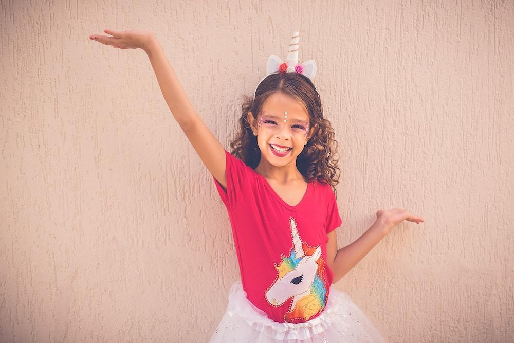 girl wearing unicorn graphic tutu skirt