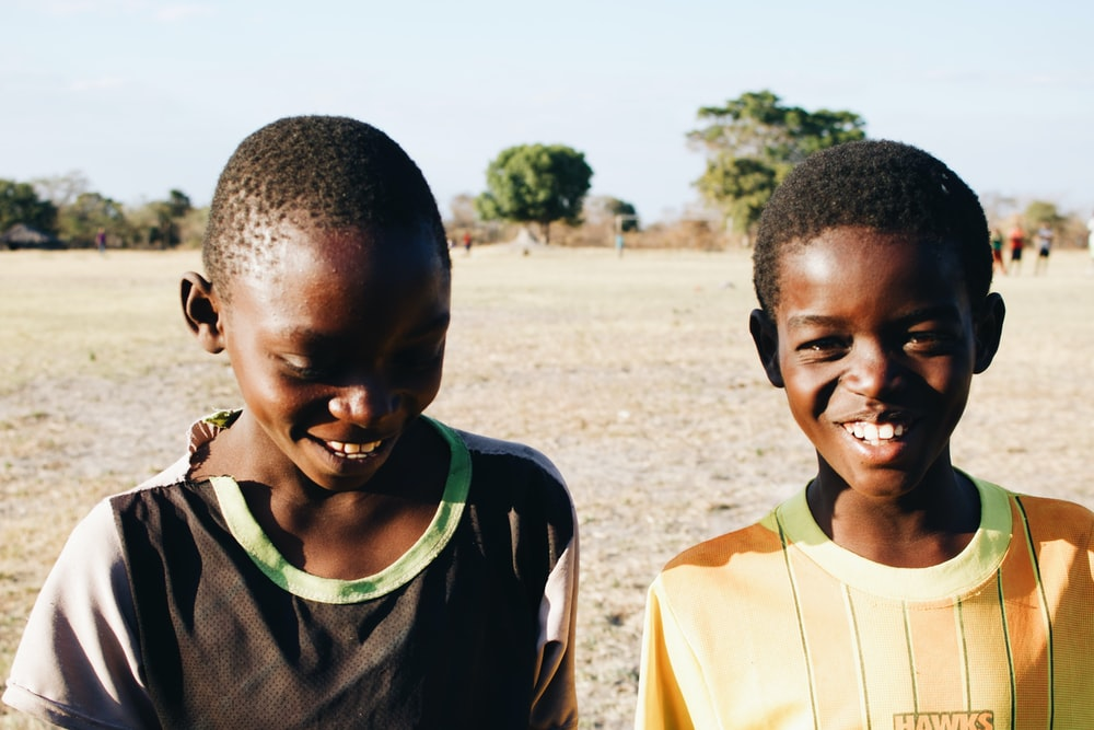 two boys smiling for photo