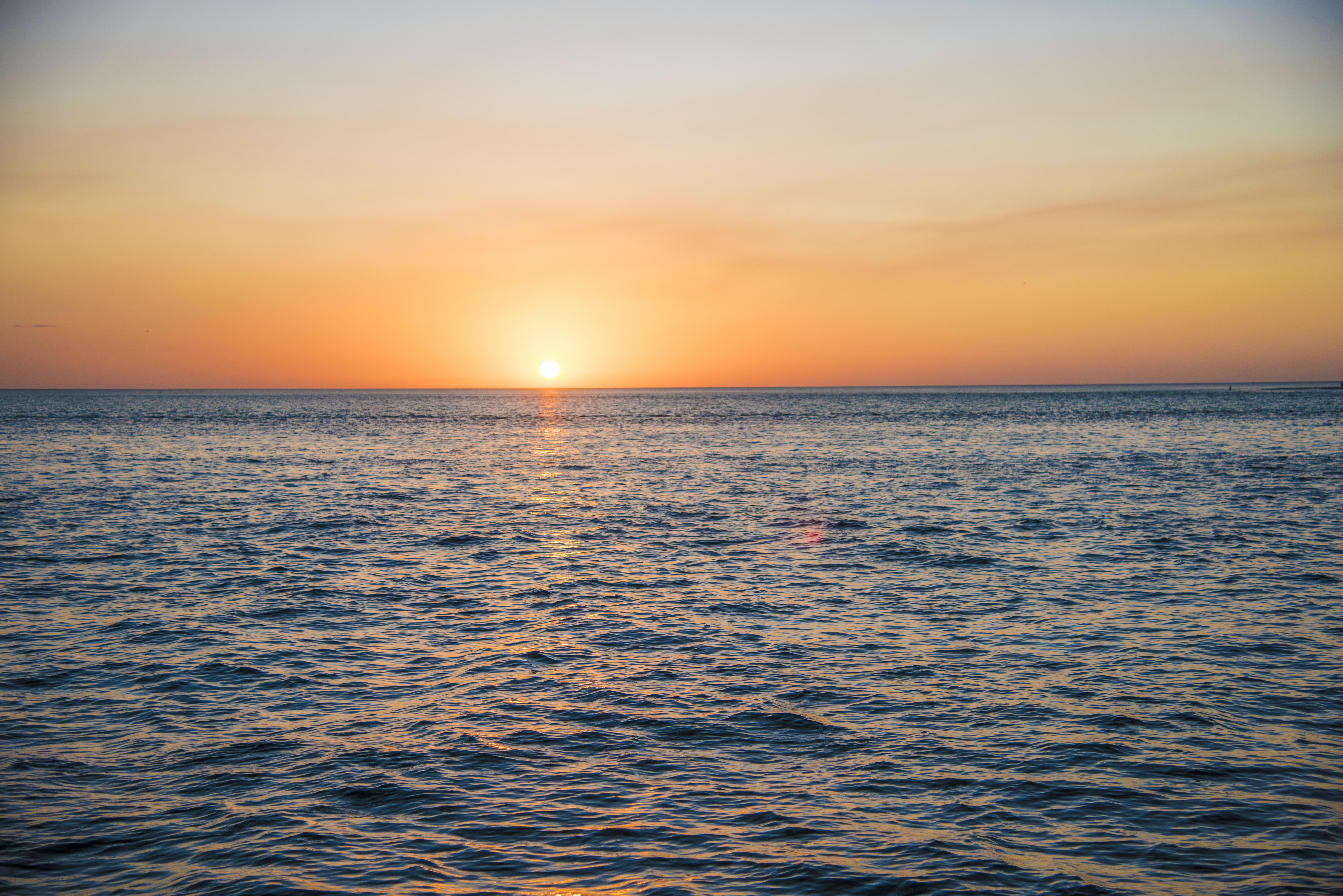 ocean water during sunset