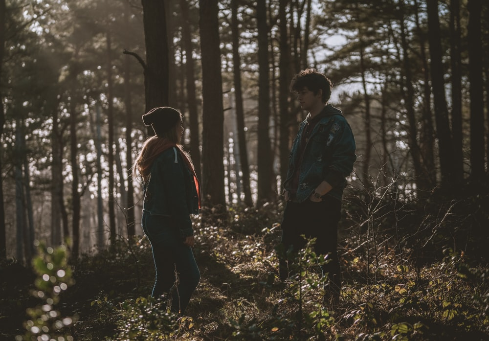 couple in woods during daytime
