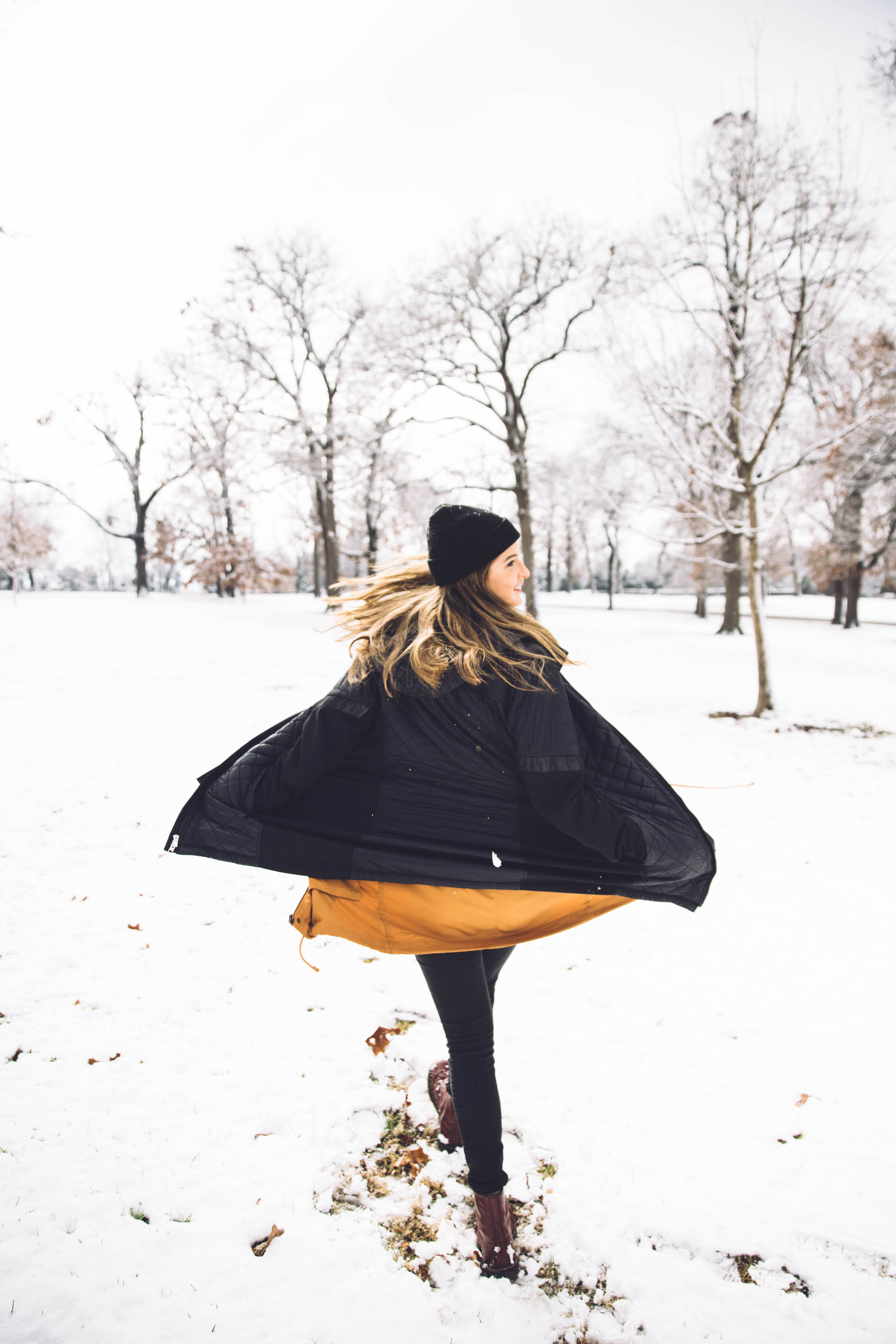 woman standing on snowy field