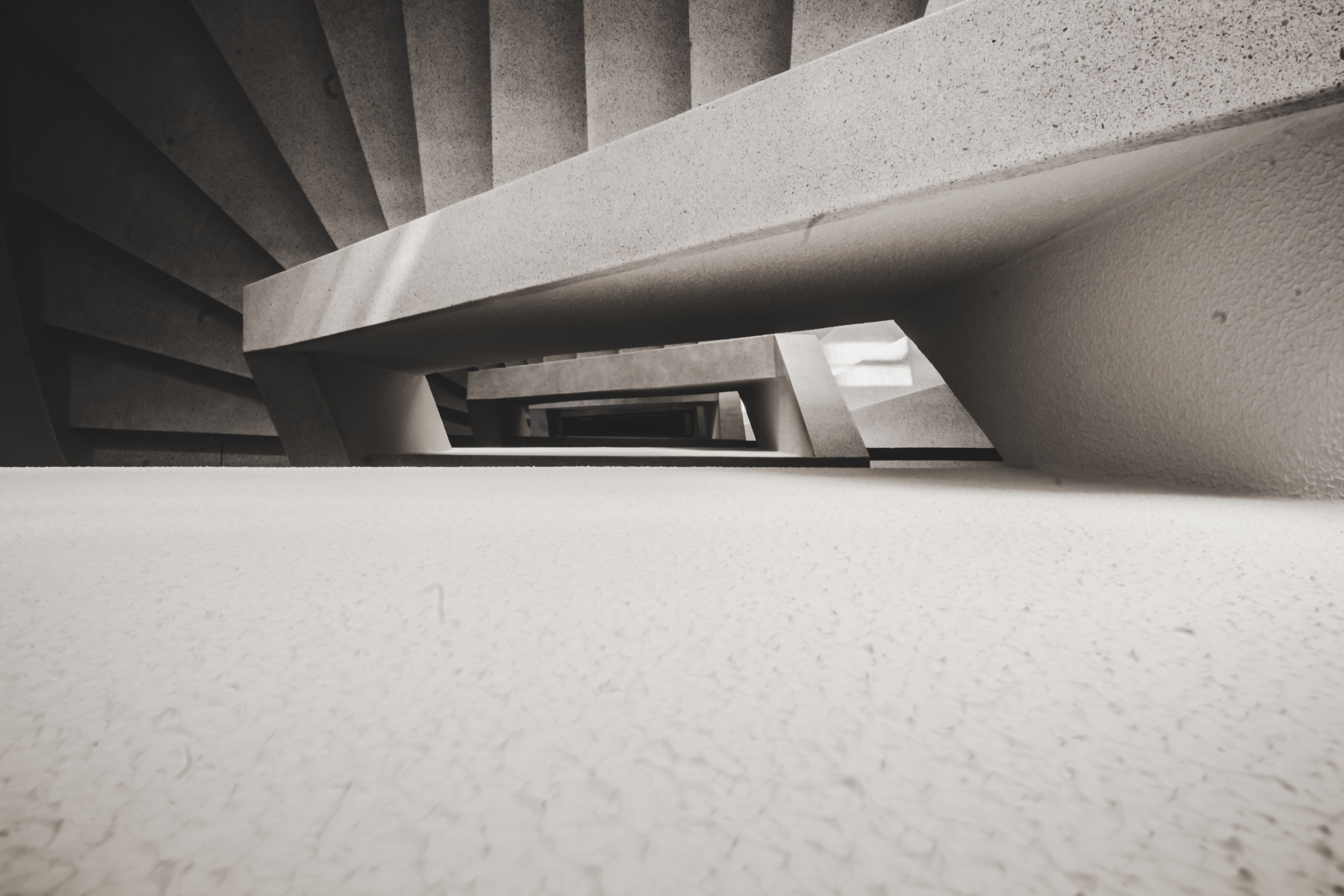 high-angle photography of white concrete spiral staircase