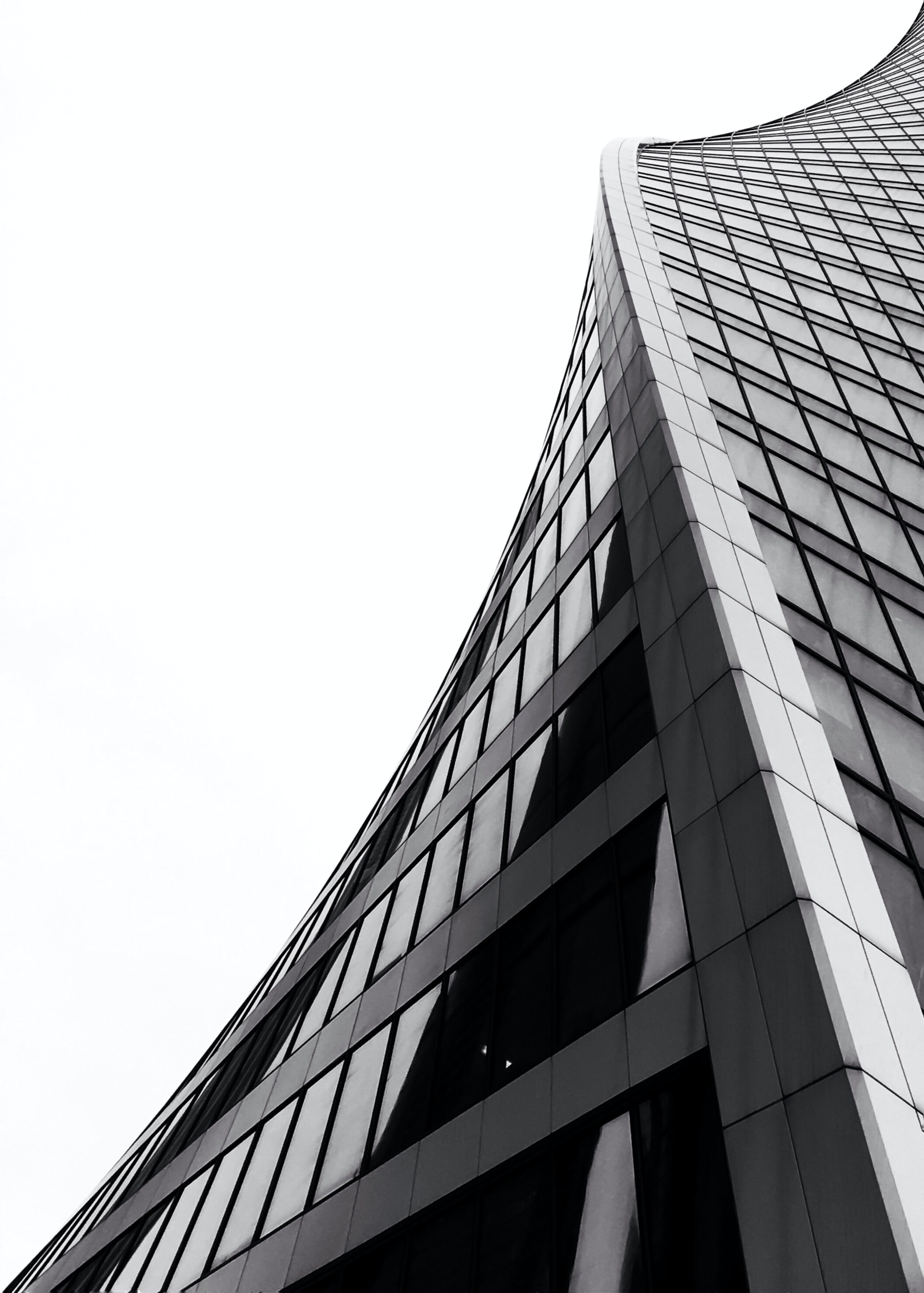 low angle photography of grey high-rise building