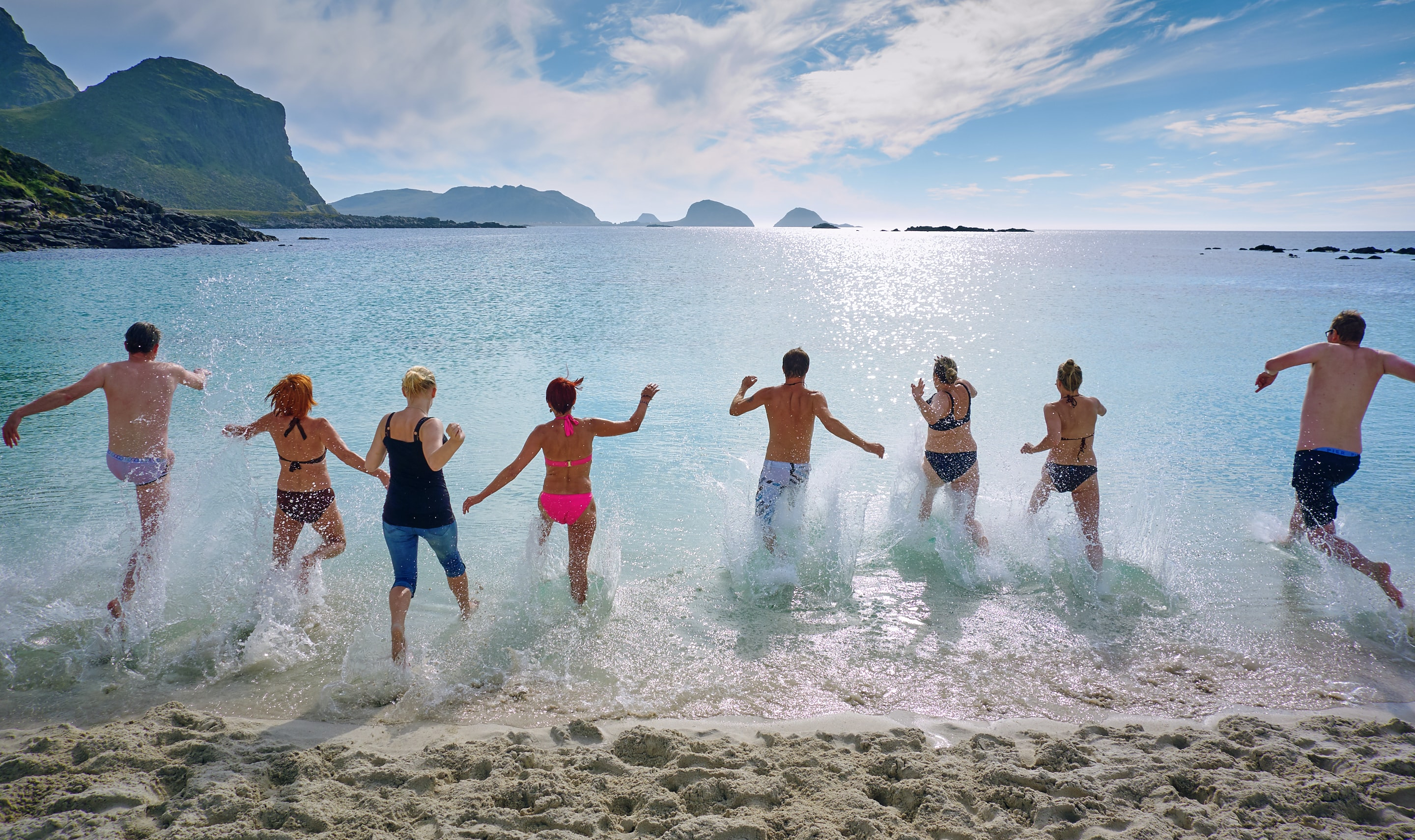 group of people playing on beach