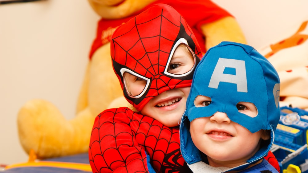 kids in spiderman and Captain America costumes