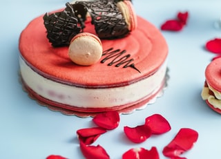 round red and white cake with cookies toppings
