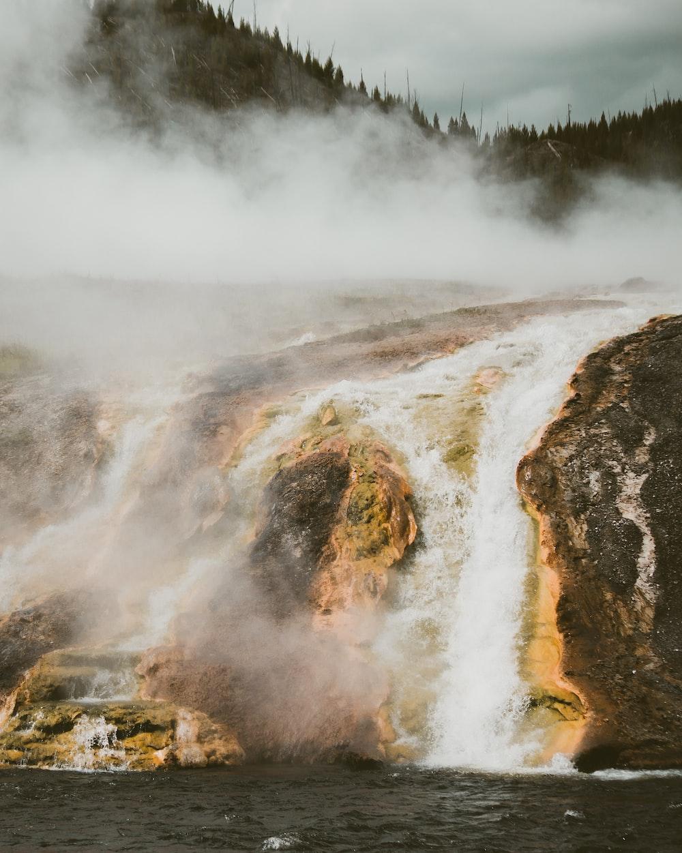 waterfalls in mountain at daytime