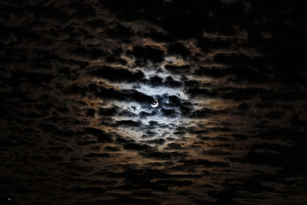 photo of moon with clouds