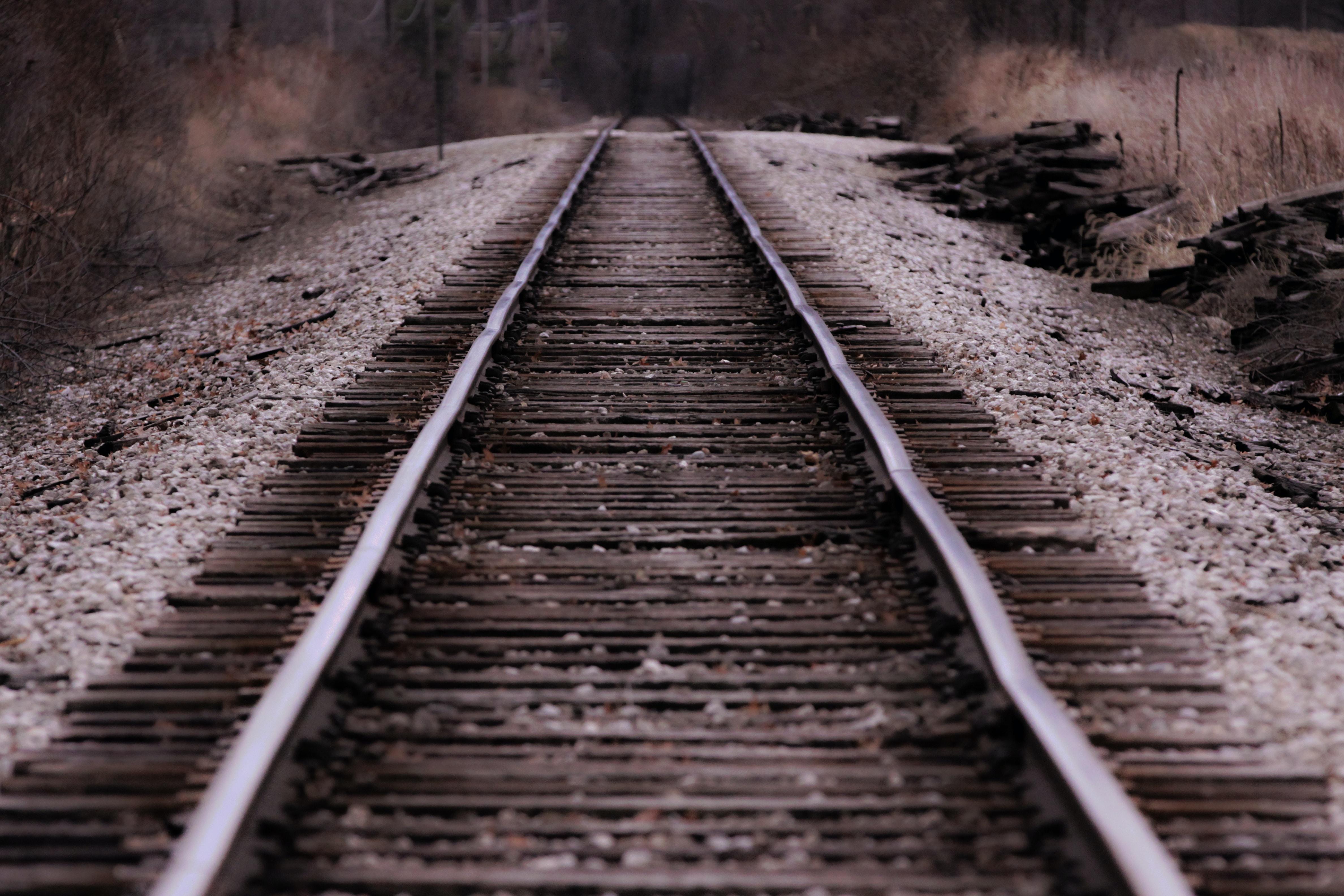 low-angle photo of train rail