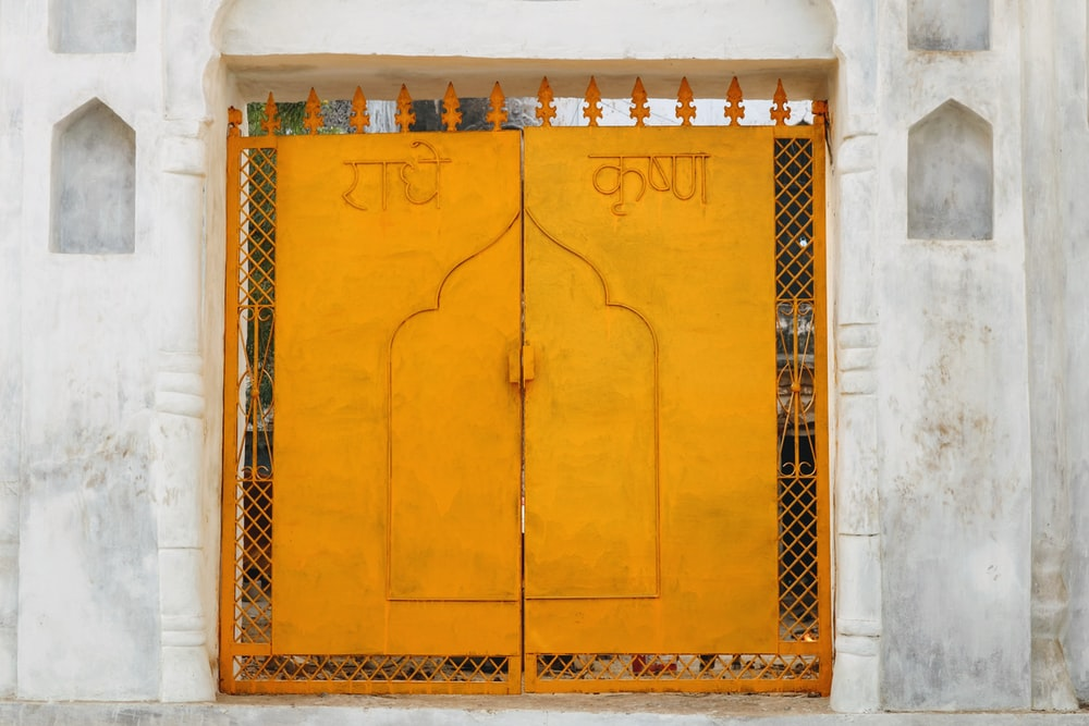 closeup photography of orange metal two-door gate