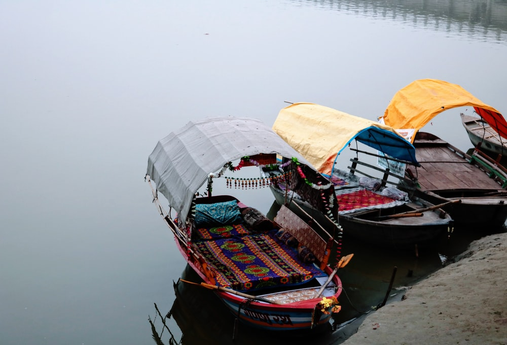 three boats on body of water