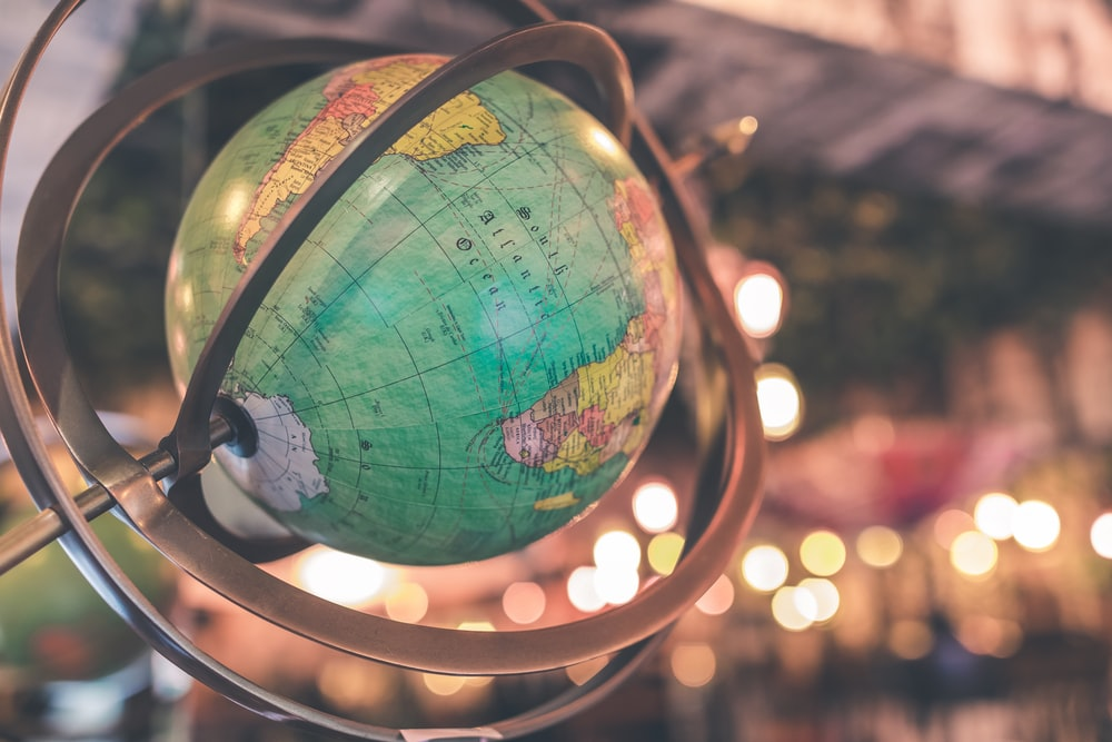 blue and multicolored desk globe close-up photography