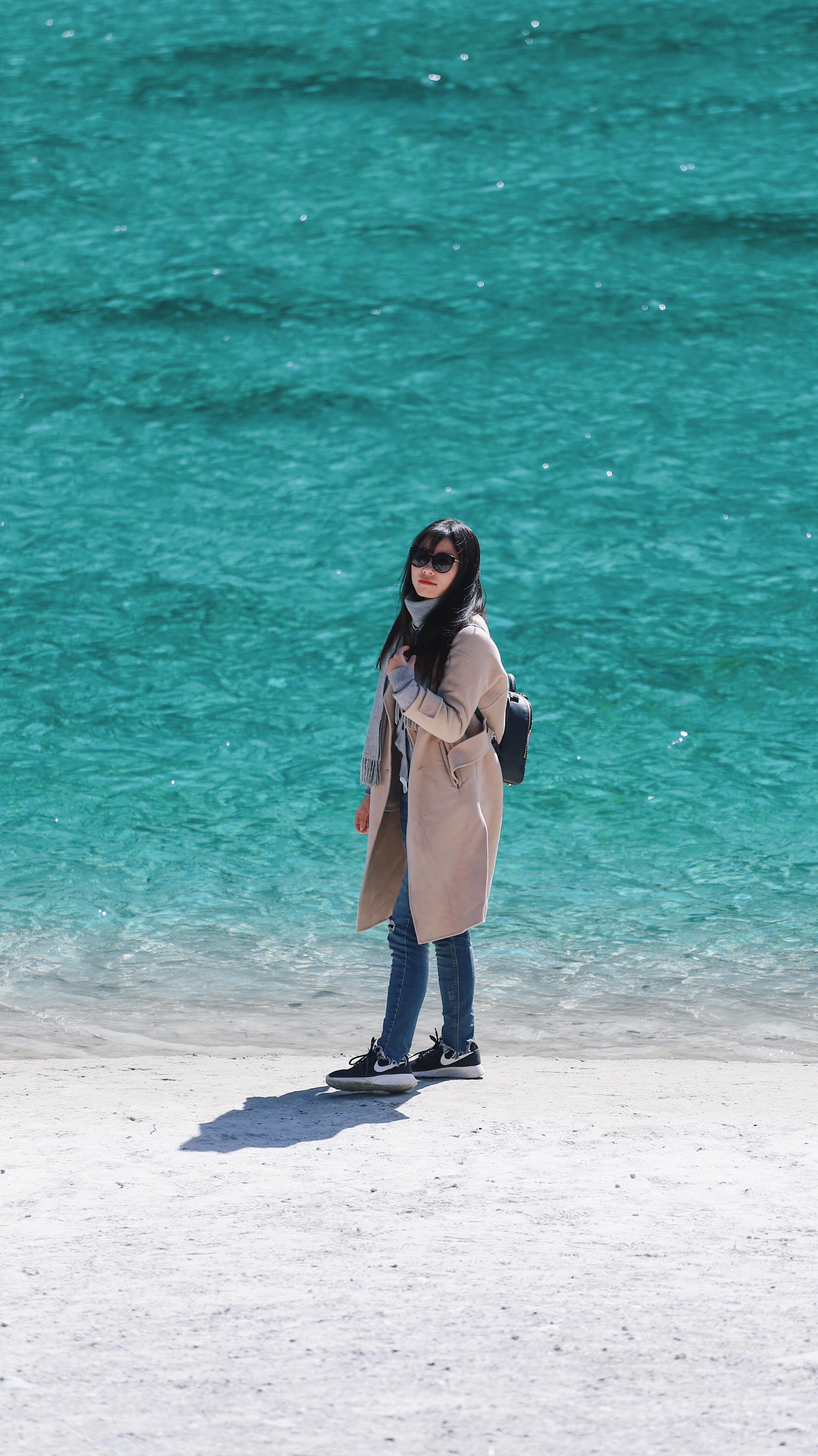 woman standing on beach shore