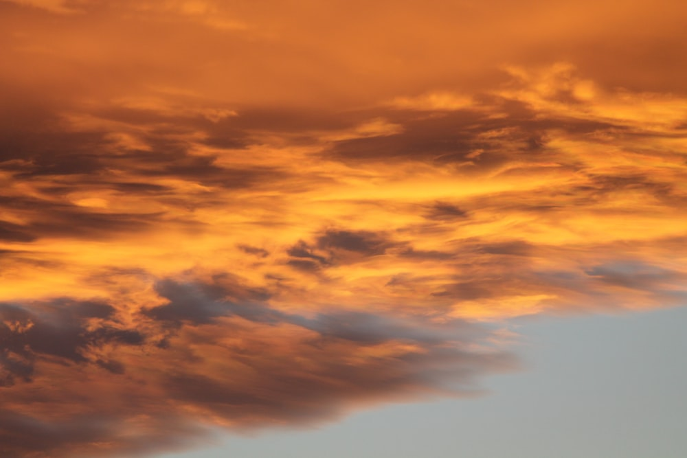 photo of clouds during golden hour