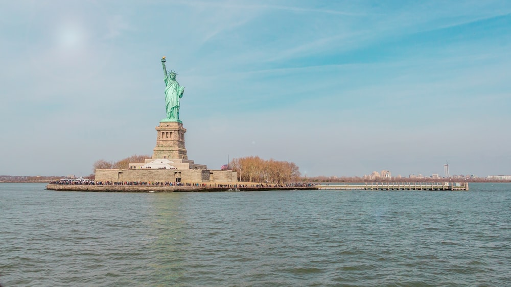 Statue Of Liberty on island surrounded by water