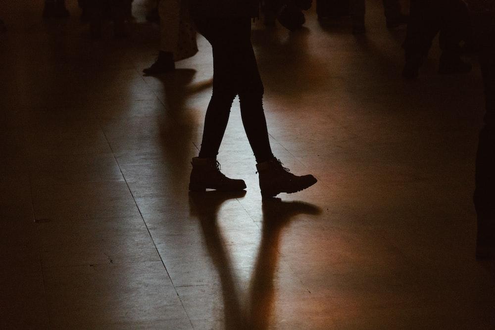 person walking on floor