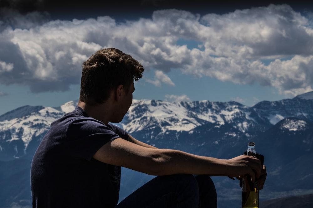 man holding beer bottle