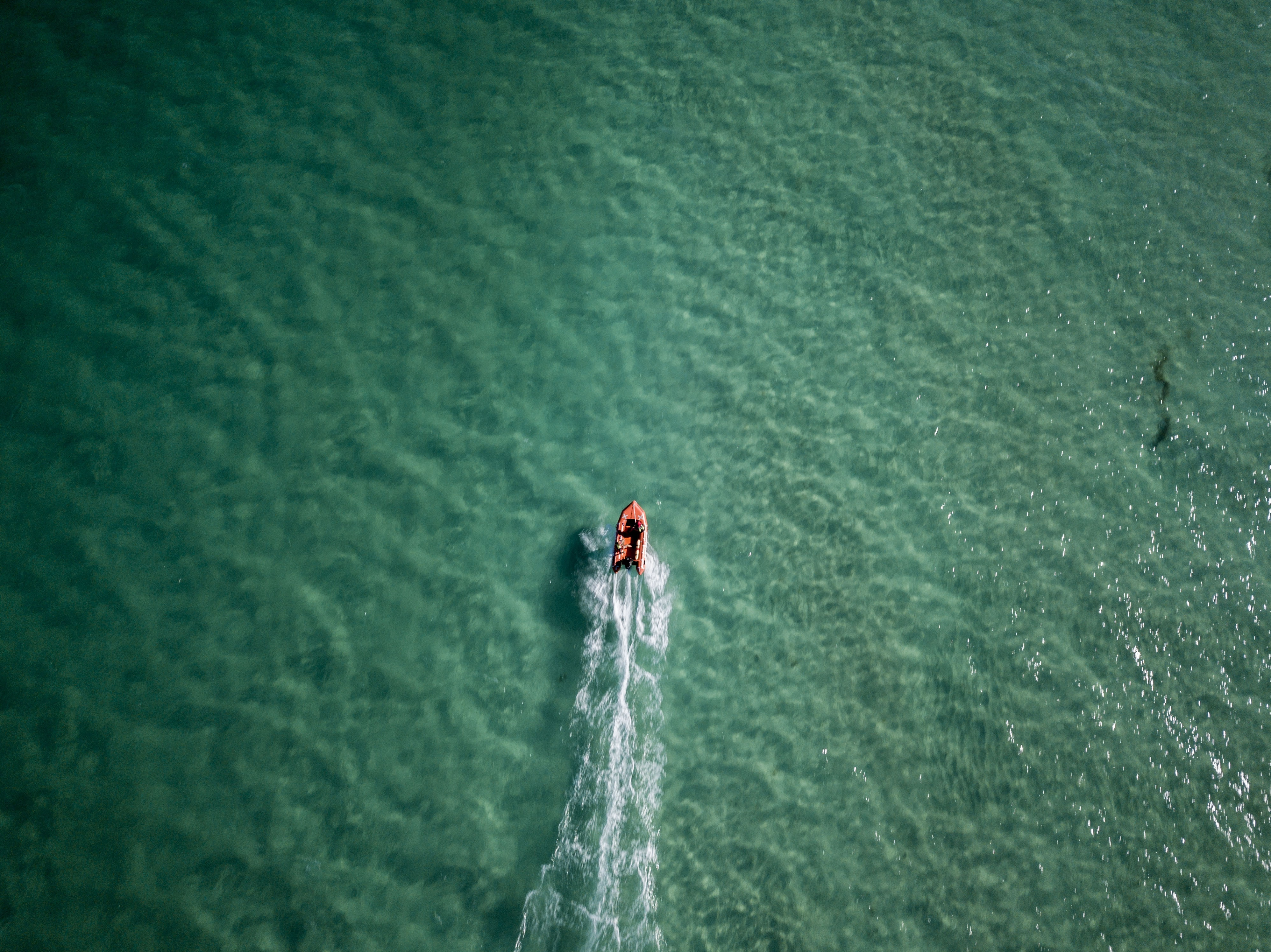 aerial photo of person riding kayak on bodies of water during daytime