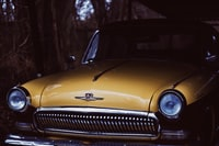 selective focus photography of yellow car