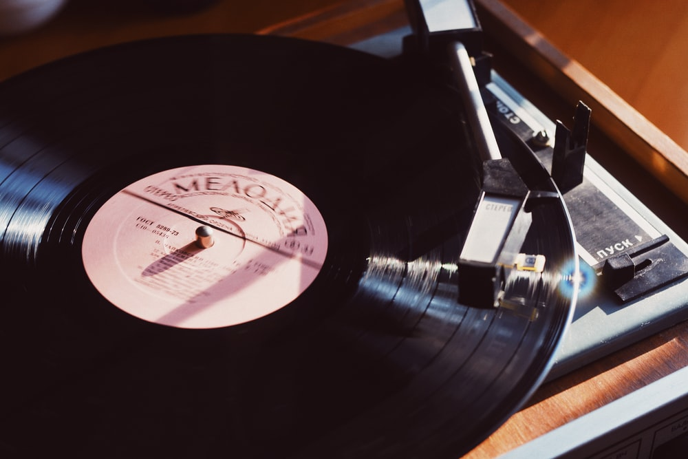 black vinyl record album on turntable