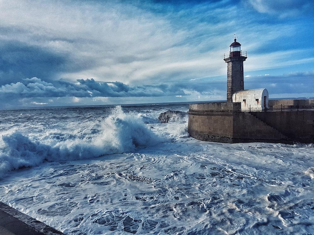 landscape photo of white lighthouse near ocean