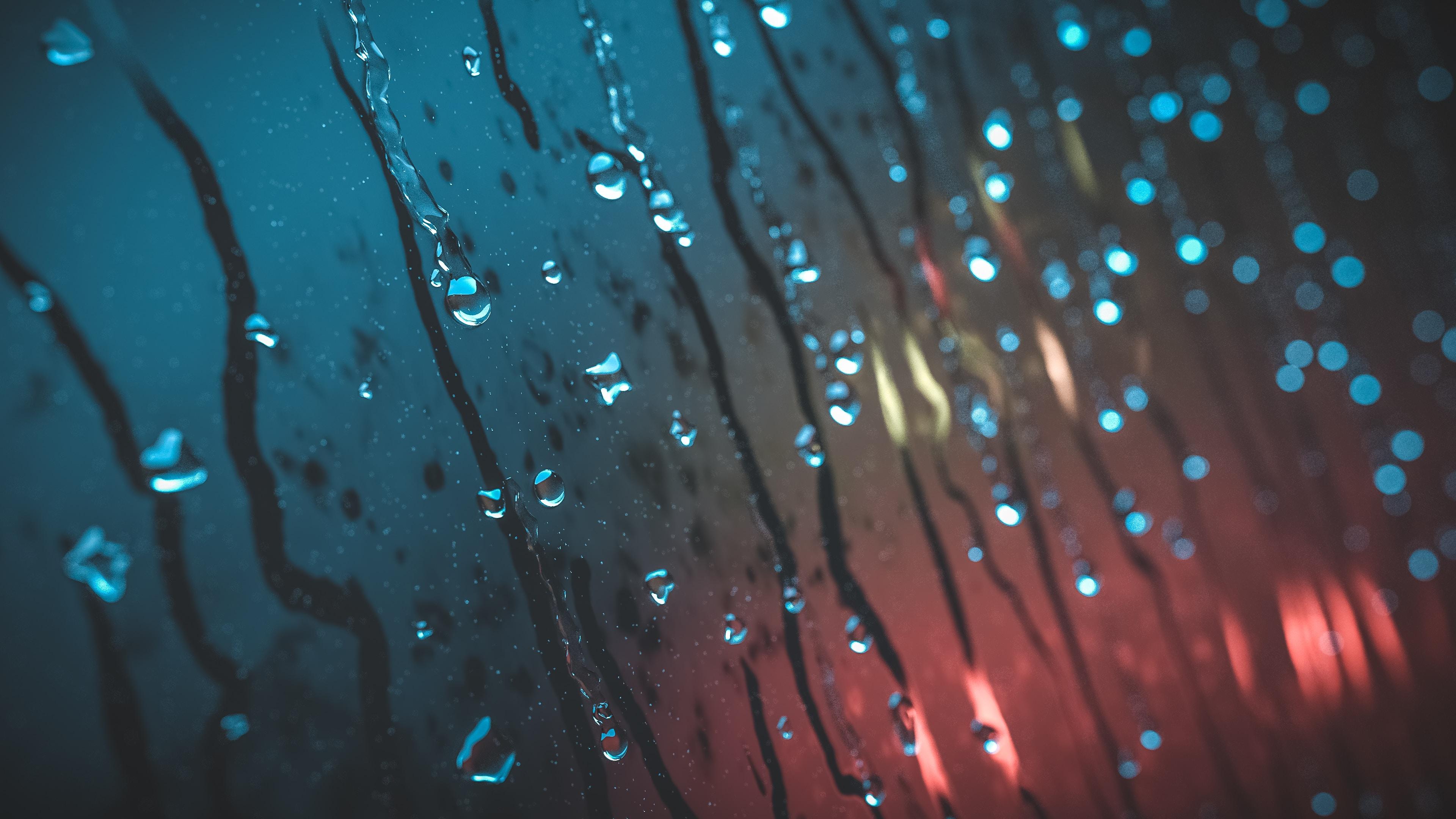 slow-mo photo of rain drops